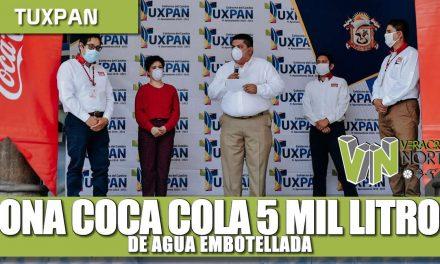 Dona Coca cola 5 mil litros de agua